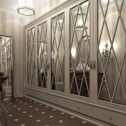 Experiential bespoke wardrobe design. Diagonal mirror fret work. Painted grey in kitchen.