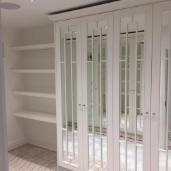 Belgravia mirror wardrobe, handmade luxury fretwork and shelves