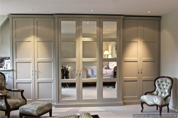 Large fitted, shaker wardrobe. Mirror and Panels. In Bedroom.