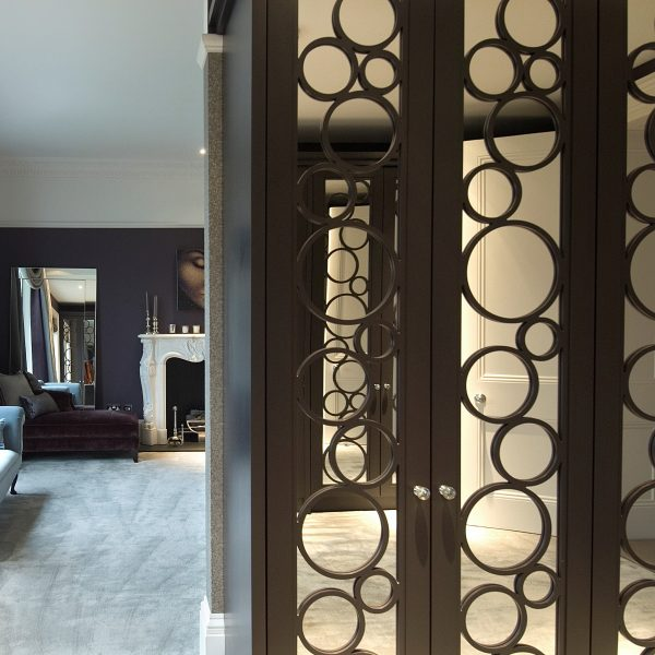Bubble mirror wardrobe mirror -Just Wardrobe Doors fitted wardrobe design. Bespoke designs to fit any room.