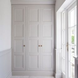 Panelled white wardrobe, handles